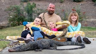 Dad Lets His Kids Play With Huge Reptiles