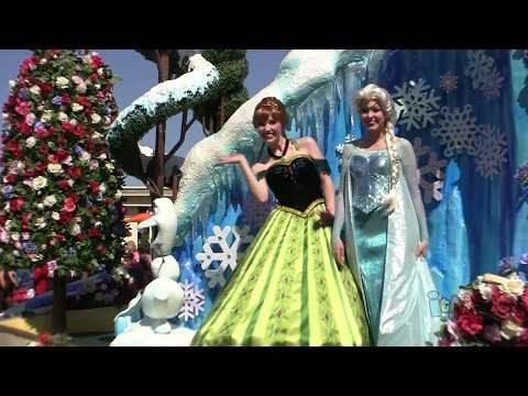 Frozen float w/ coronation dress Anna, Elsa, Olaf in Festival of Fantasy Parade at Walt Disney World