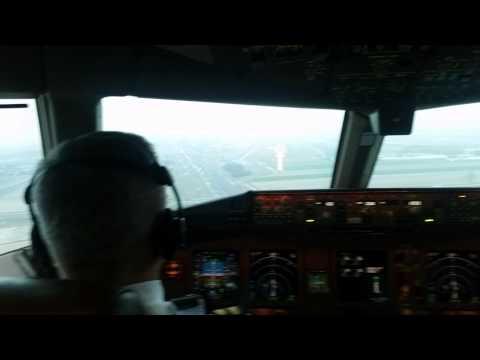 Boeing 777 landing cockpit view Qatar Airways