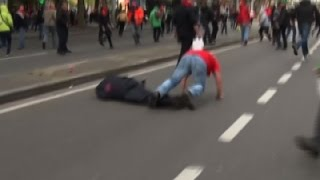 Raw: Protester Knocks Out Brussels Police Chief