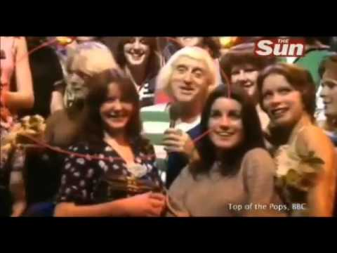 Jimmy Savile molests girl live on Top Of The Pops 1976