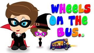Wheels On The Bus Go Round & Round | The Halloween Song For Tiny Tots With Tim & Tia