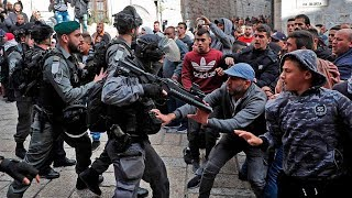 Palestinians scuffle with Israeli forces, rally against Trump