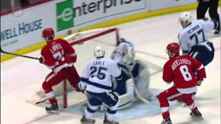 Gotta See It: Larkin near goal fakes Bob Cole out of broadcast booth