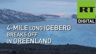 Enormous iceberg filmed breaking from Greenland glacier