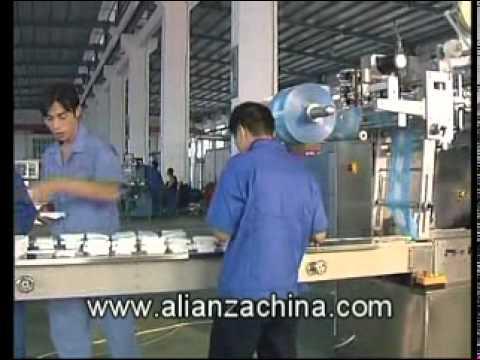 Maquina para fabricar y doblar toalla humeda