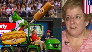 Woman hit in face by flying hot dog during Phillies game - TomoNews