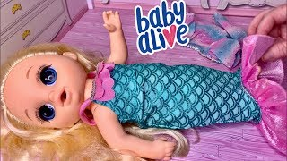 Baby Alive Video Emma try's on the new My Life Mermaid outfit and feeding