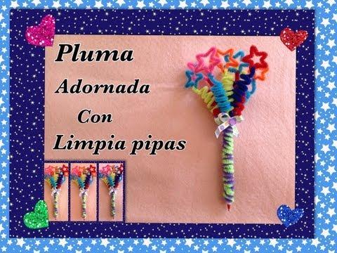 PLUMA O LAPICERO ADORNADO CON LIMPIA PIPAS ( ESTRELLAS) .