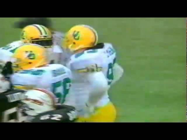 Oregon DE Mark Slymen tackles OSU QB Don Shanklin for a loss 11-19-1994