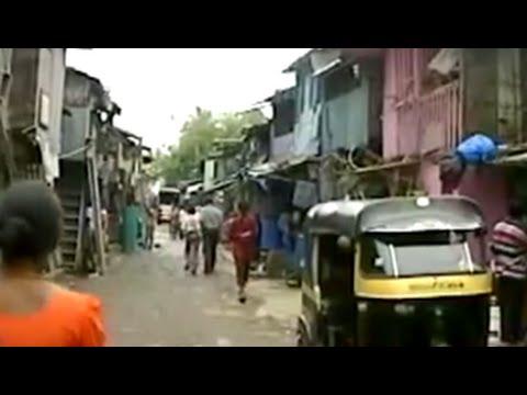 Why has Mumbai's slum redevelopment scheme failed to gain momentum?