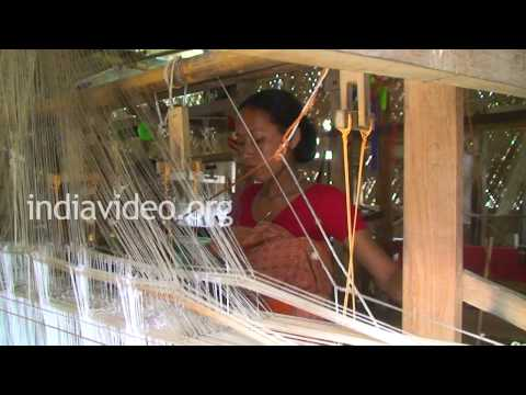 Women weaving silk in Sualkuchi, Assam