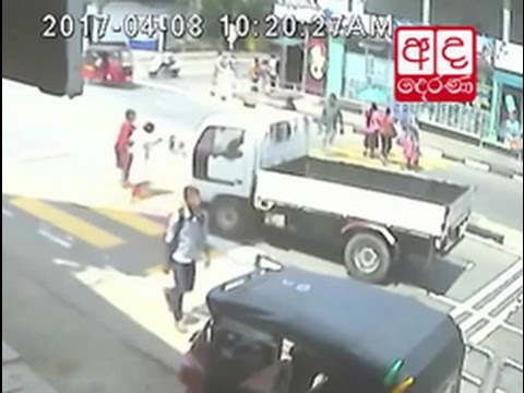 cctv lorry hits two |eng