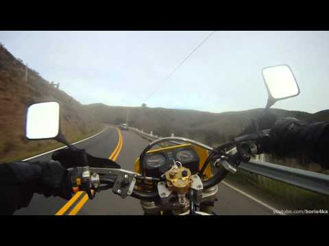 Car overtakes motorcycle in front of cop, gets pulled over