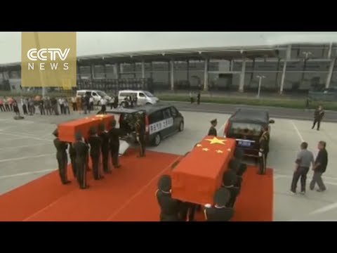Solemn ceremony held at airport in China's Henan, as bodies of 2 Chinese UN peacekeepers repatriated