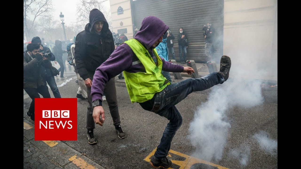 Yellow vest movement: Paris police fire tear gas at protesters - BBC News