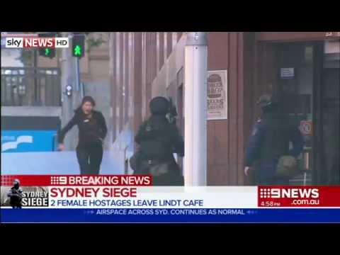 Two Woman Flee Sydney Cafe Where Gunman Holding Several Hostages
