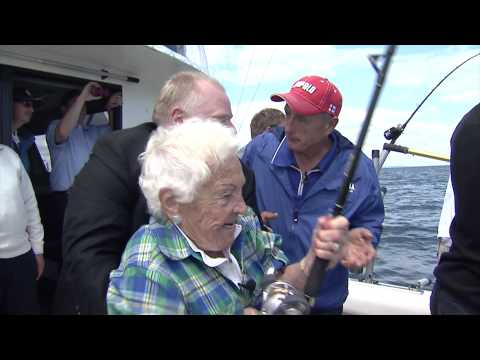 Hazel McCallion lands the big one as Rob Ford and Italo Labignan cheer her on.