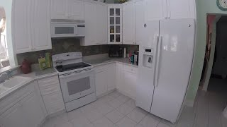 (How to paint kitchen cabinets white?)