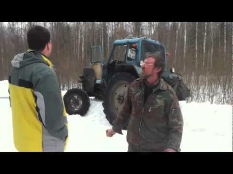 Honda Ridgeline достаёт трактор из сугроба