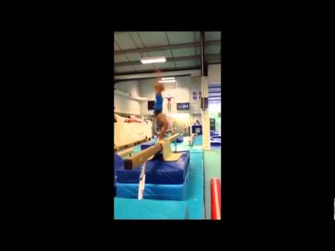 Danusia Francis SIDEWAYS back tuck on beam!