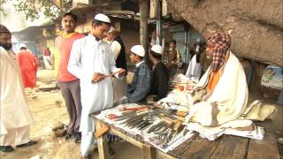 Old man selling local made knives for a living, Delhi