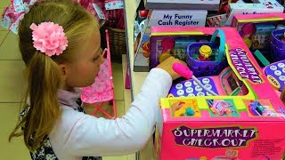 Funny Kids Shopping in the Supermarket for Babies