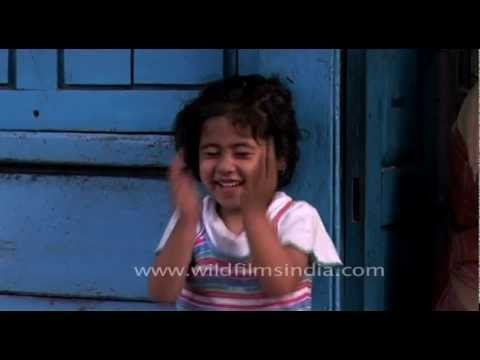 Cute little Nepali girl blushes at the camera