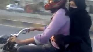 Boy wheeling on Bike with his Girl Friend