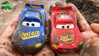 Disney cars tunnel through play. Car washing in a puddle