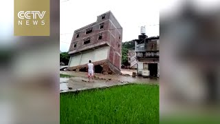 Severe flooding causes Guangxi building collapse