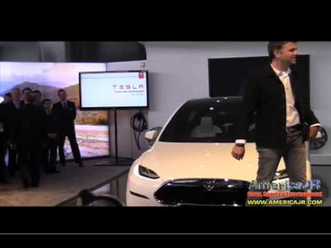 Tesla unveils the 2014 Model X crossover SUV at North American International Auto Show