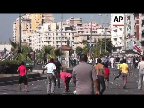 Clashes in Alexandria between supporters and opponents of Morsi; Cairo rally for army