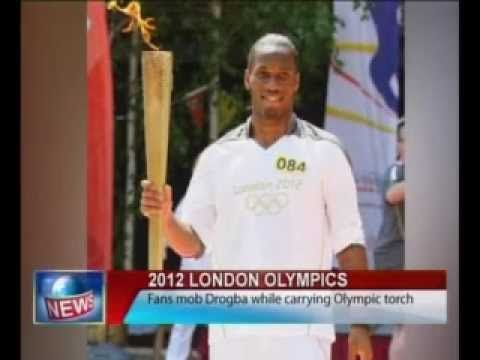 Didier Drogba Mobbed by Thousands of Screaming Fans as he Carries the Olympic Torch.flv
