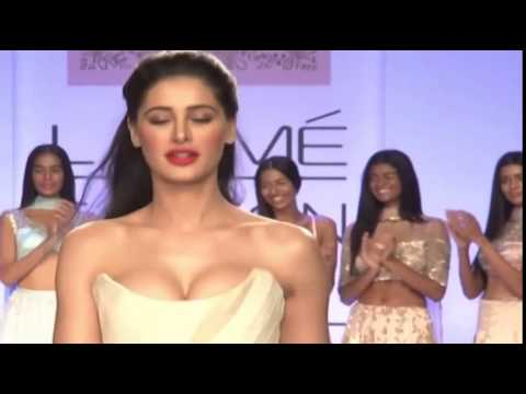 Nargis Fakhri in her tightest dress popping out her boobs