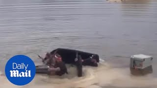 Guys try to cross lake in off-road vehicle and manage to SINK it