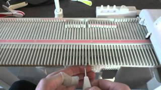 Manual lace on a knitting machine