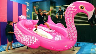 Super Trampoline VS WORLD'S LARGEST Inflatable!