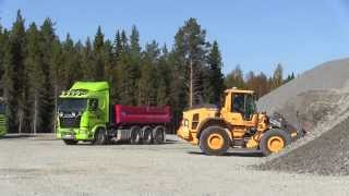 Volvo L90H loading gravel on Scania R480 8x4*4 in a quarry
