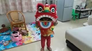 Little kid playing lion dance