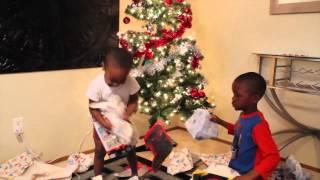 Zay Zay and Jojo open Christmas presents
