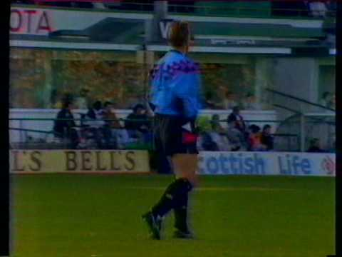 Scottish premier Division match from 5th October 1991. Hibs take their unbeaten run in all competitions to 14 games. Interviews with Alex Miller & Murdo MacLeod. All rights BBC Sportscene.