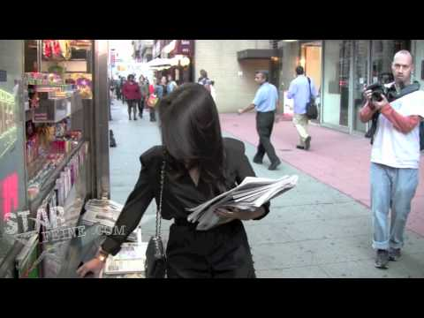Kourtney Kardashian Buys Newspapers From a Newstand in New York City