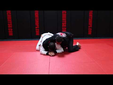 Jiu Jitsu Techniques - Turtle Guard Attack - Lapel Choke Image 1