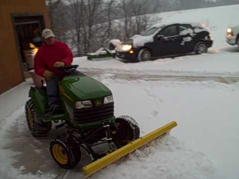 JOHN DEERE X595 PLOWING SNOW
