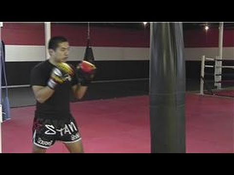 Kickboxing Training : Hitting the Punch Bag Image 1