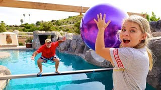 DONT Get KNOCKED Into The POOL! $10,000 *WRECKING BALL CHALLENGE*
