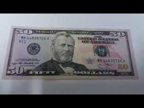 Видео как проверить 10 долларов на подлинность