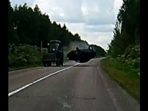 Car Flipped by Tractor