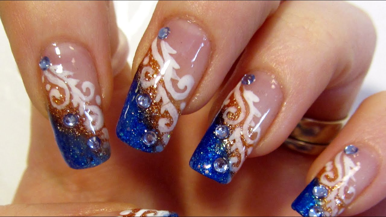 Glittery Blue And Copper Tips White Swirls And Rhinestones